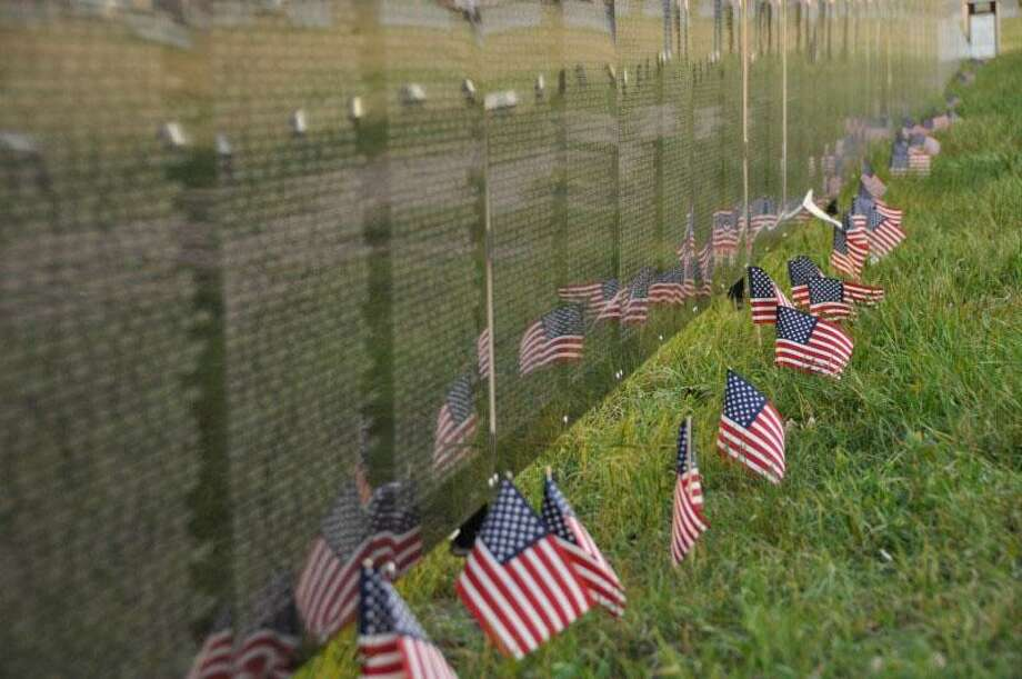 The Roger Sherman Chapter, Daughters of the American Revolution, which serves the New Milford area, will host the Wall That Heals in New Milford Oct. 27 to 30. The Wall That Heals, a 250-foot replica of the Vietnam Veterans Memorial, along with a mobile education center, will arrive at Youngs Field on Youngs Field Road Oct. 26 at 11 a.m. Photo: Courtesy Of DAR / The News-Times Contributed