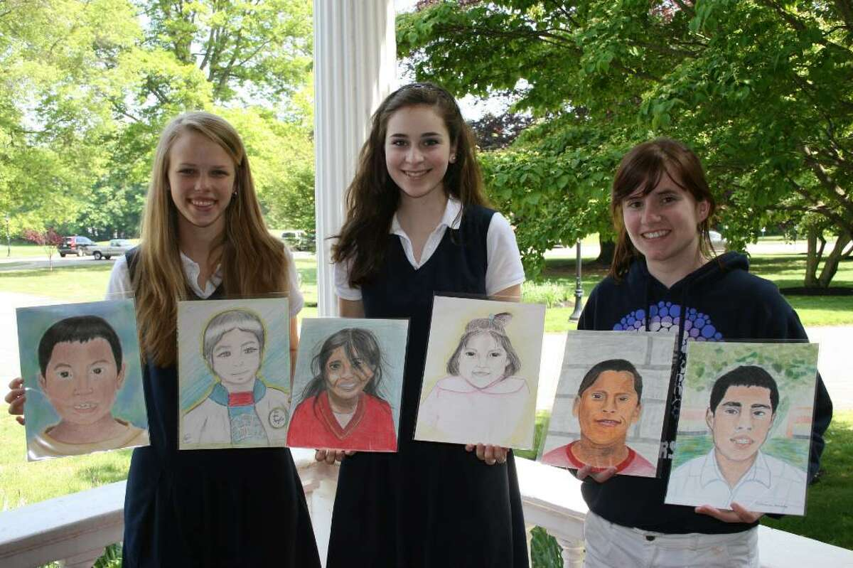 Lauralton Hall Art Club students, from left, Teresa Starzecki, '11, of Shelton, Chloe Walker, '11, of Fairfield, and Emma Molloy, '10, of New Canaan, pose with the portraits they created of orphaned children in Peru as part of a nationwide program called The Memory Project.