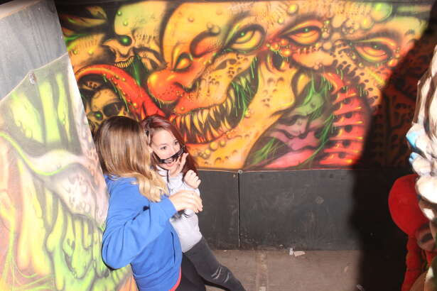 Haunted house attendees get spooked at Creepy Hollow Haunted House in Rosharon, Texas, south of Houston.