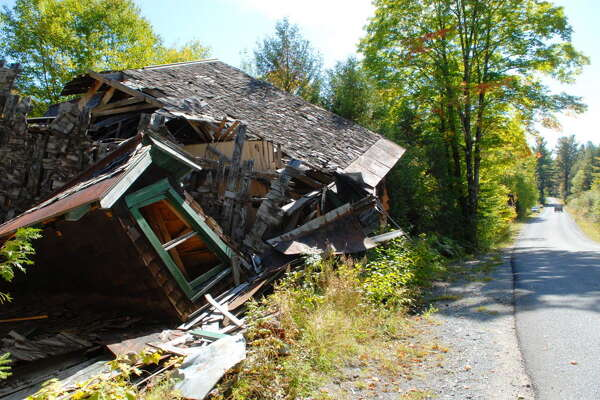 A view of one of the dilapidated buildings in the former Adirondac Village in the Town of    Newcomb, NY on Monday, Sept. 21, 2009.(Paul Buckowski / Times Union)