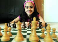 Nine-year-old chess prodigy Martha Samadashvili at her family home on Friday Aug. 1, 2014 in Albany, N.Y. (Michael P. Farrell/Times Union)