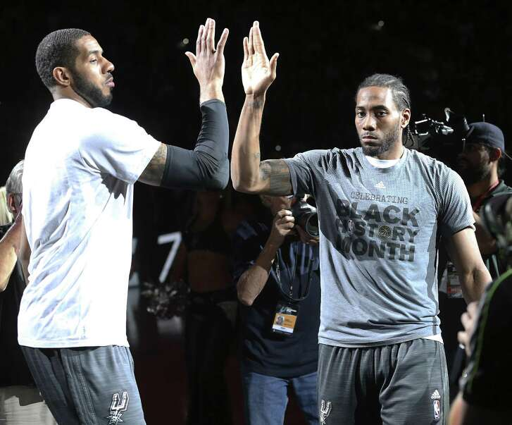 With the retirement of Tim Duncan, the Spurs will lean on LaMarcus Aldridge (left) and Kawhi Leonard (right) for leadership.