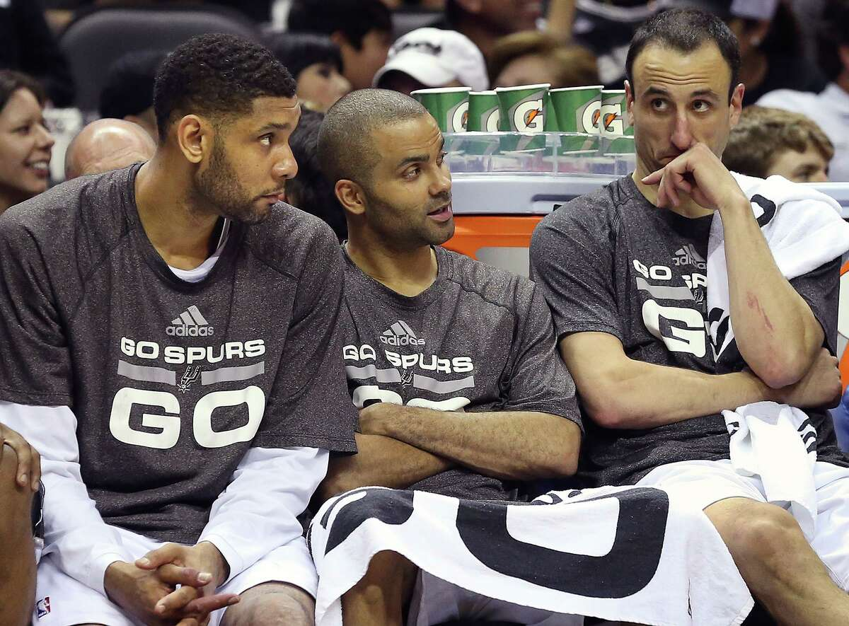 The Big Three, Tim Duncan, Tony Parker, and Manu Ginobili chat in the fourth quarter as the Spurs play the fifth game of the Western Conference Finals against the Oklahoma City Thunder on May 29, 2014.