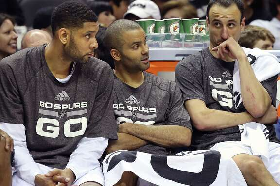 "It will be strange for many fans not to see the Spurs' ""Big Three"" of Tim Duncan (from left), Tony Parker and Many Ginobili on the Spurs' bench this season."