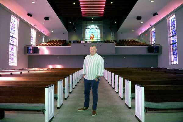 Pastor Patrick Kelley poses in the newly renovated West End Church on Friday, Oct. 21 in Houston.