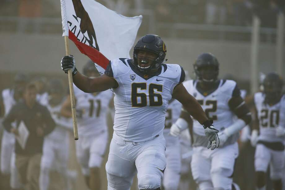 Offensive lineman Chris Borrayo leads the California Bears onto the field before an NCAA college football game in Corvallis, Ore., on Saturday, Oct. 8, 2016. (AP Photo/Timothy J. Gonzalez) Photo: Timothy J. Gonzalez, Associated Press