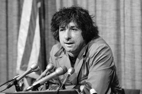 In this Dec. 6, 1973 file photo, political activist Tom Hayden, husband of Jane Fonda, tells newsmen in Los Angeles that he believes public support was partially responsible for the decision not to send him and others of the Chicago 7 to jail for contempt. Hayden, the famed 1960s antiwar activist who moved beyond his notoriety as a Chicago 8 defendant to become a California legislator, author and lecturer, has died at age 76. His wife, Barbara Williams, says Hayden died on Sunday, Oct. 23, 2016, in Santa Monica of a long illness.