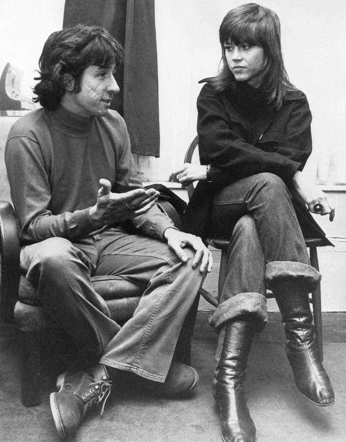 In this Dec. 26, 1972 file photo, actress Jane Fonda, right, and Tom Hayden, one of the founders of SDS, talk at the home of a friend in London, after their arrival from Paris. Hayden, the famed 1960s antiwar activist who moved beyond his notoriety as a Chicago 8 defendant to become a California legislator, author and lecturer, has died at age 76. His wife, Barbara Williams, says Hayden died on Sunday, Oct. 23, 2016, in Santa Monica of a long illness.