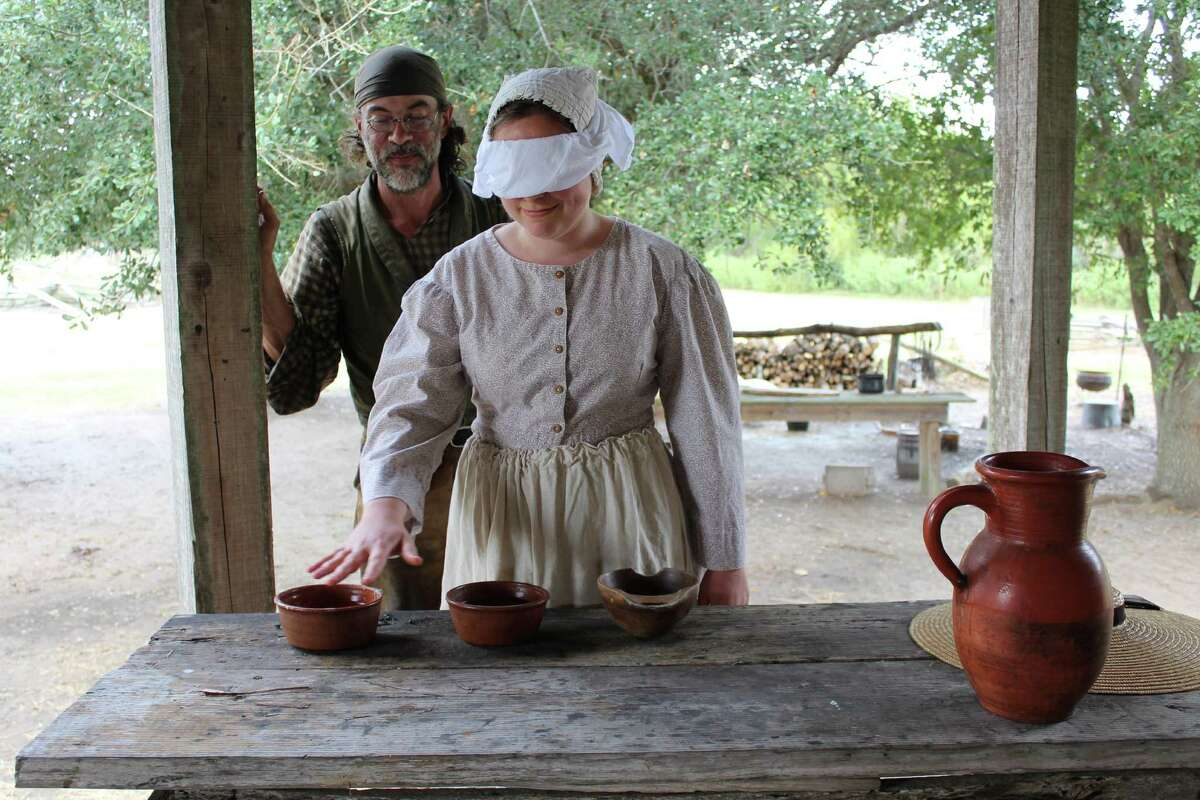 George Ranch Historical Park 1830s Interpreters J.R. Thomas and Hannah Moses play a pioneer Halloween game called