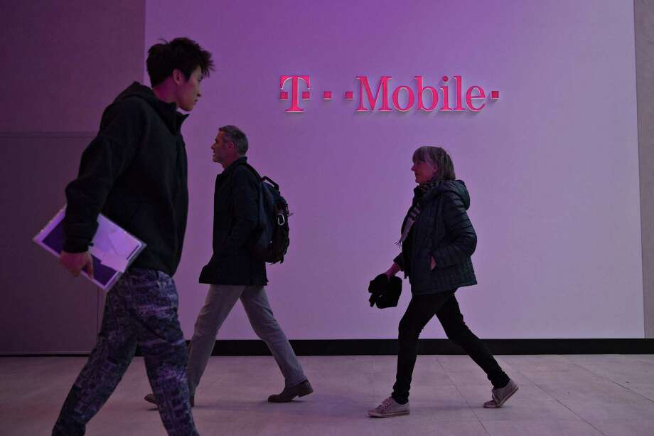 In its latest quarterly report, T-Mobile reported adjusted earnings before interest, tax, depreciation and amortization rose to $2.6 billion, while the company added 969,000 total monthly subscribers. The results show that T-Mobile's maverick chief executive officer, John Legere, is finding a way to balance user growth with the costs required to keep customers coming. Photo: Daniel Acker /Bloomberg News / © 2016 Bloomberg Finance LP
