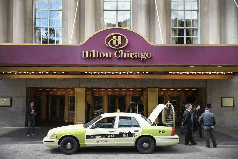 HNA Group is snapping up a 25 percent ownership stake of the Hilton hotel chain for about $6.5 billion, the latest attempt by a Chinese interest to acquire real estate in the U.S. Photo: Getty Images /File Photo / 2013 Getty Images