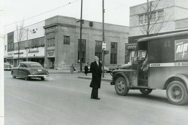 Corner of McDonald and Main streets. 1950 (Imagine That! now occupies the building in background.)