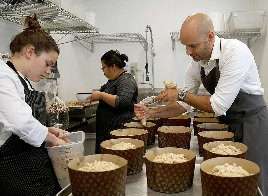 Chef Roy Shvartzapel makes a test batch of apple-cranberry panettone topped with cinnamon streusel with sous chefs Lindsey Cameron (left) and Mary Ann Chou. Photo: Liz Hafalia, The Chronicle