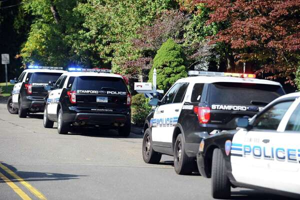Stamford police block off Westwood Rd. after a man barricaded himself inside his home with a gun while making threats in north Stamford, Conn. on Monday, Oct. 17, 2016.
