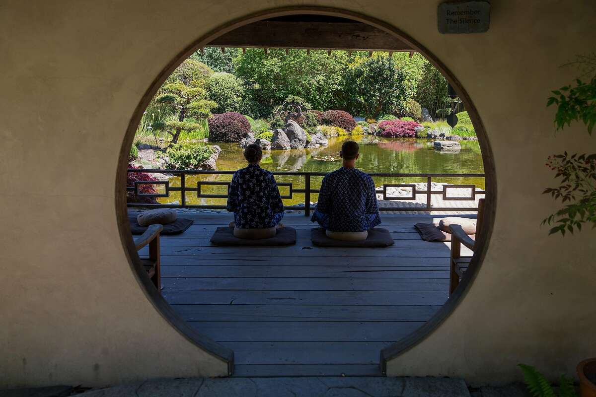 Rene� and Jason Robinson in the meditation garden at Osmosis Day Spa in Freestone, Calif., Friday, April 17, 2015. The spa serves boxed lunches from neighboring restaurant Fork.