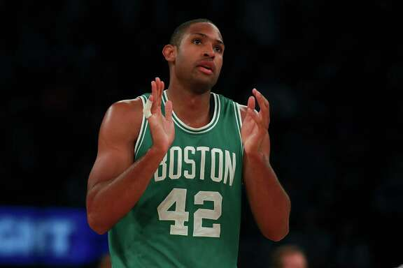 NEW YORK, NY - OCTOBER 15:  Al Horford #42 of the Boston Celtics celebrates after a basket against the New York Knicks during the second half of their preseason game at Madison Square Garden on October 15, 2016 in New York City. NOTE TO USER: User expressly acknowledges and agrees that, by downloading and or using this photograph, User is consenting to the terms and conditions of the Getty Images License Agreement.