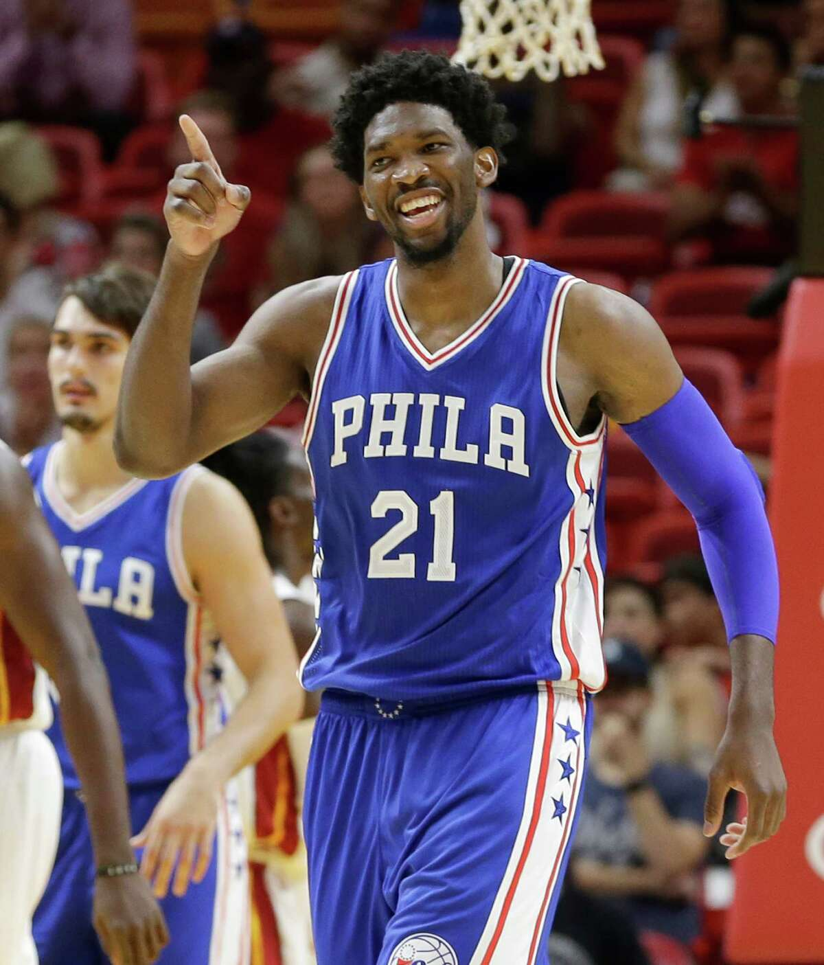 Philadelphia 76ers center Joel Embiid celebrates after scoring against the Miami Heat during the second half of an NBA preseason basketball game, Friday, Oct. 21, 2016, in Miami. (AP Photo/Alan Diaz)