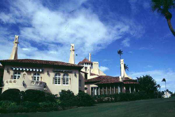 A 1995 exterior photo of the lavish West Palm Beach mansion Mar-A-Lago. The home is owned by Donald Trump and is the site of his wedding reception to take place on January 22, 2005. The home was built by cereal heiress Marjorie Merriweather Post, and has been the site of such celebrity get-a-ways as Michael Jackson's honeymoon with Lisa Marie Presley.  REUTERS/Marc Serota