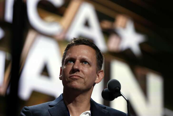 Billionaire tech investor Peter Thiel look overr the podium before the start of the second day session of the Republican National Convention in Cleveland, Tuesday, July 19, 2016. (AP Photo/Carolyn Kaster)