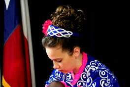 Becca Bryan ties her shoe before practicing at Tew Academy of Irish Dance in Clear Lake.