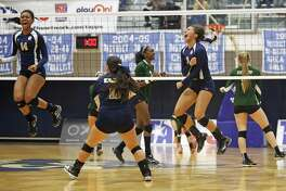 Holy Cross' Brie-anna Armstrong and Henrianna Ibarra (right) react after a point in a TAPPS 4A state semifinal volleyball match at South San High School on Nov. 13, 2015.