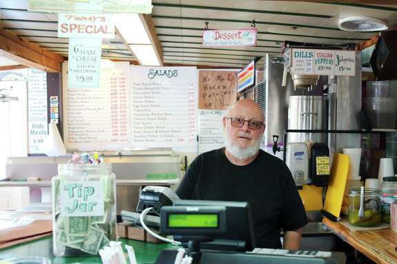 Neptune Subs' owner Vinny Schillaci stands in his restaurant that will be replaced with a one-way feeder road on Texas State Highway 146 when proposed construction plans are completed.