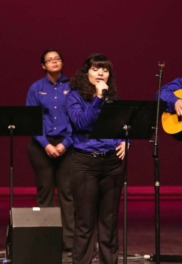 "Victor Strife Priscilla Hinojosa performs a vocal solo as the LCC Spanish Traditional Group plays a rendition of the classic Mexican ballad ""Señora Señora"" Sunday afternoon, during the 24th Annual Mother's Day Concert at Laredo Community College's Guadalupe and Lilia Martinez Fine Arts Center Theater. See related photo, story in Monday's paper and e-Edition."