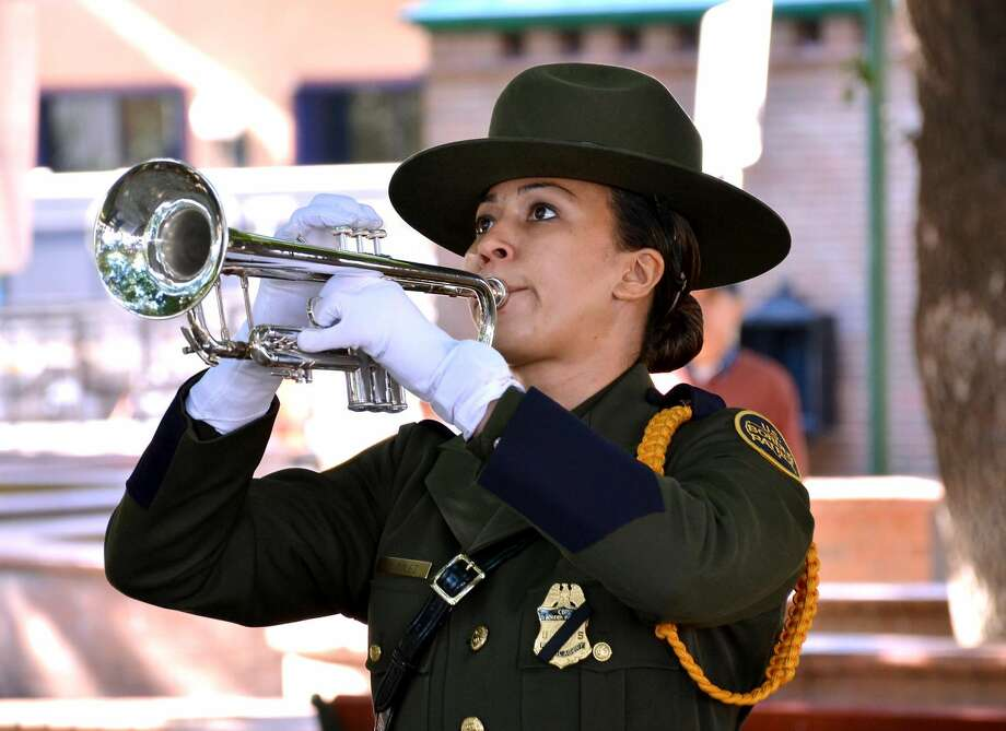 "U.S. Border Patrol agent N. Miles plays ""Taps"" at the annual Law Enforcement Memorial ceremony at Jarvis Plaza Thursday morning. Representatives from county and federal law enforcement agencies remembered fallen officers at the event. (Cuate Santos/Laredo Morning Times)"