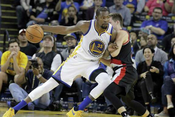 Kevin Durant (35) drives to the basket against Patrick Connaughton (5) during the second half as the Warriors played the Portland Trail Blazers during a preseason game at Oracle Arena in Oakland, Calif., on Oct. 21, 2016.