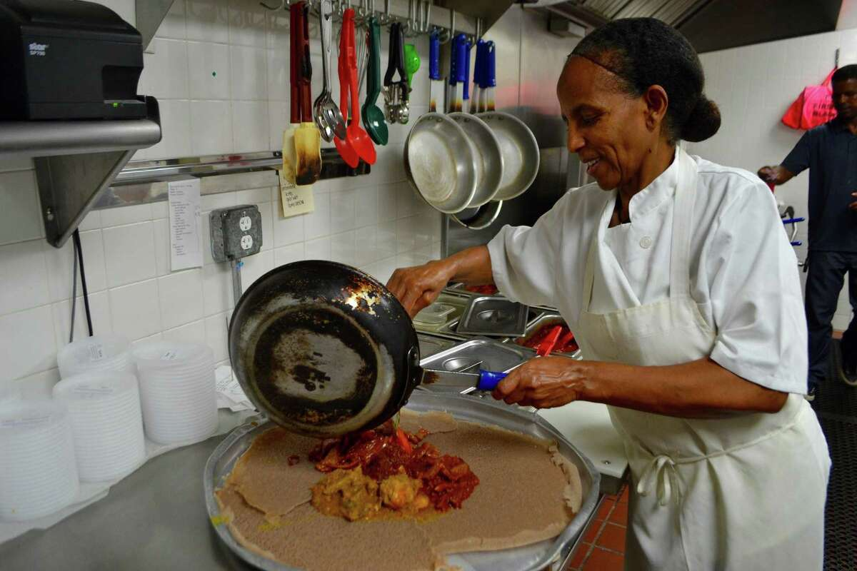 Hadas Mengesha in the kitchen of Teff, an Ethiopian/Eritrean restaurant in Stamford. Teff is listed in the business directory on ctblackowned.com, which is merging with shopblackct.com.