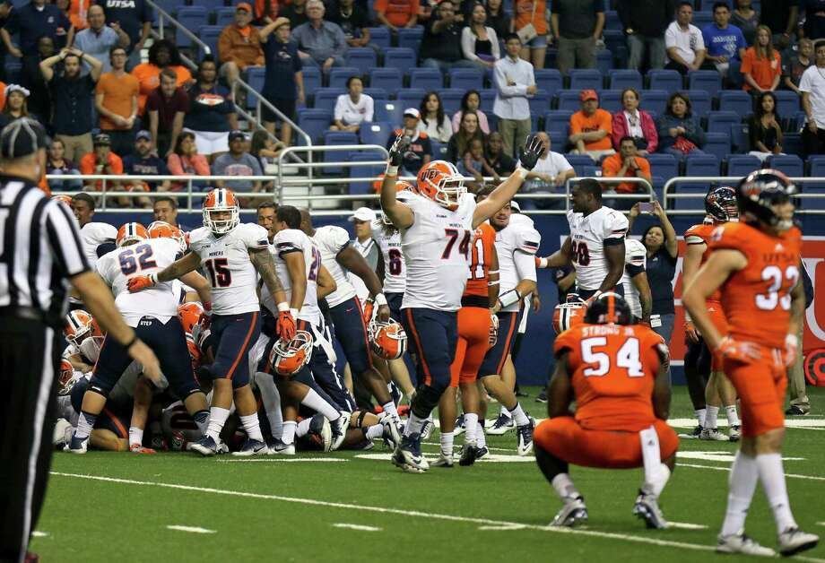 UTEP (white) celebrates after defeating UTSA 52-49 in five overtimes in San Antonio on Oct. 22, 2016. Photo: Edward A. Ornelas /San Antonio Express-News / San Antonio Express-News