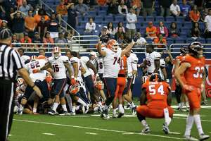 UTEP (white) celebrates after defeating UTSA 52-49 in five overtimes in San Antonio on Oct. 22, 2016.