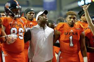 UTSA head coach Frank Wilson stands with players including Baylen Baker (99), and Devron Davis (1) during the school song after their loss to UTEP in San Antonio on Oct. 22, 2016. UTEP won 52-49 in five overtimes.