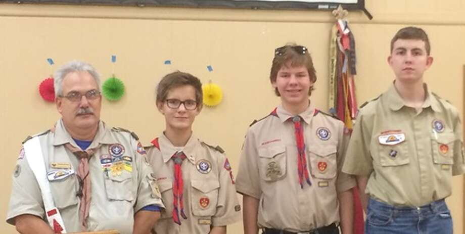 Scoutmaster David Albee stands with Boy Scout Troop 464's latest Eagle Scouts, from right, Jacob Kennedy, Will Hatfield and Sam Hatfield. Photo: Boy Scout Troop 464