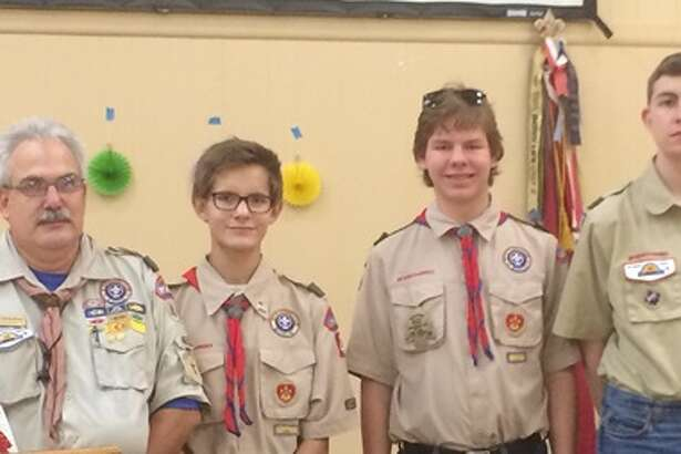 Scoutmaster David Albee stands with Boy Scout Troop 464's latest Eagle Scouts, from right, Jacob Kennedy, Will Hatfield and Sam Hatfield.