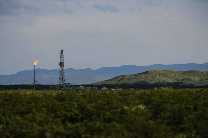 An Apache Corp. flare and drilling rig sit north of the Davis Mountains in Balmorhea. Some analysts say they remain cautious about the Alpine High oil and gas field. It's still too early to know if Apache's expectations for the field will bear out, said Hassan Eltorie, a principal energy analyst for IHS Markit.