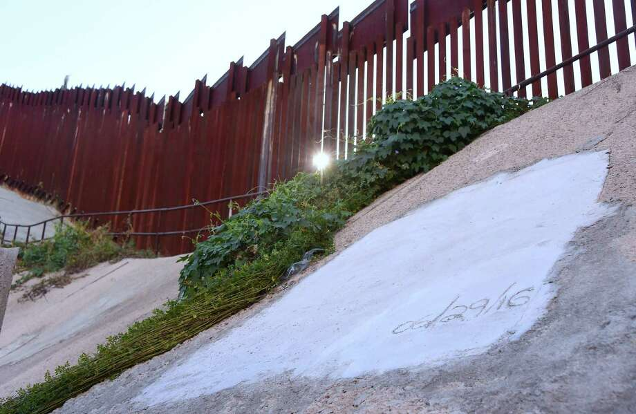 Much of the border is already fenced, including this area in Nogales, Arizona. And migrants find a way to beat them, border residents tell reporters. Photo: AFP / Getty Images / File Photo / AFP or licensors
