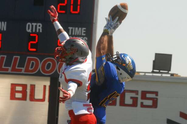 Wayland Baptist University receiver Preston Woodard, right, outjumps a defender in the end zone to catch a touchdown pass during a game earlier this season. Wayland received votes in the NAIA top-25 polll this week for the first time since they re-started the football program in 2012.