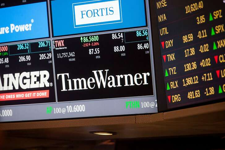 Time Warner Inc. signage is displayed on a monitor on the floor of the New York Stock Exchange (NYSE) in New York, U.S., on Monday, Oct. 24, 2016. U.S. stocks rose to a two-week high, beginning one of the earnings reporting season's busiest weeks as a flurry of deal activity spurred optimism in equity markets. Photographer: Michael Nagle/Bloomberg