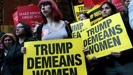 Activists rally against Republican presidential candidate Donald Trump outside Trump Tower in New York City. Readers continue to comment on this bitter presidential campaign.