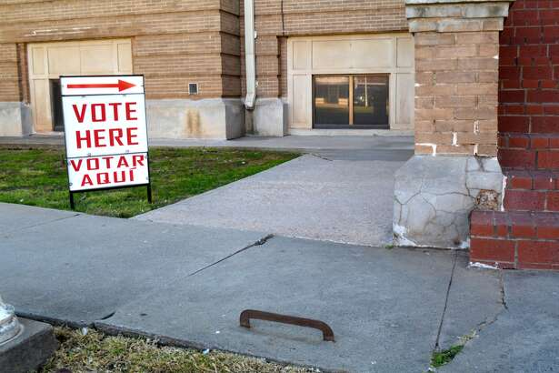 """Vote Here"" signs went up Monday morning outside the basement entrances of the Hale County Courthouse with the start of early voting for the Nov. 8 General Election. Early voting runs Oct. 24-28 and Oct. 31-Nov. 4, in the courthouse basement, Abernathy City Hall, Hale Center ISD Technology Building at 1209 Ave. D and Petersburg City Hall. Election officials report a brisk start with 80 ballots cast at the courthouse during the first two hours of voting Monday. Those planning to use the north courthouse entrance need to watch their step to avoid a decades' old relic – a blade imbedded in the sidewalk to scrape mud off your boots before entering the building."