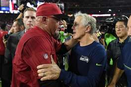 GLENDALE, AZ - OCTOBER 23:  Head coaches Bruce Arians of the Arizona Cardinals and Pete Carroll of the Seattle Seahawks greet each other after the NFL game at University of Phoenix Stadium on October 23, 2016 in Glendale, Arizona.  The Seattle Seahawks and Arizona Cardinals tie 6-6.  (Photo by Norm Hall/Getty Images)