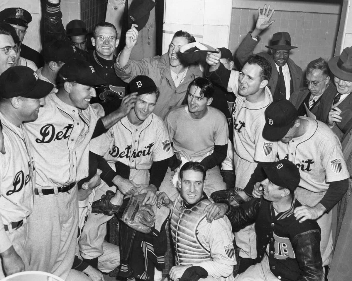 It did not end well: The Detroit Tigers celebrate their World Series victory in the game 7 over the Chicago Cubs in 1945. Roy Cullenbine is tipping the cap of winning pitcher Hal Newhauser. His catcher, Paul Richards, in sweatshirt is next to Newhauser.