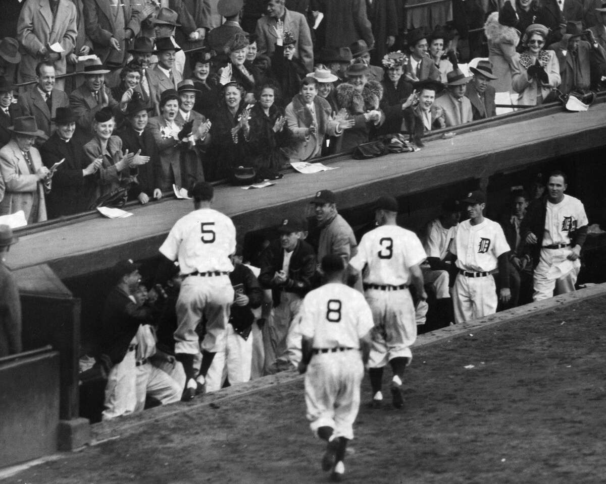 Tigers Hank Greenberg greeted by teammates after hitting 3-runhome run in fifth inning of Game 2. 1945 World Series between the Detroit Tigers and Chicago Cubs. The Tigers won the Series, four games to three. Photo from Sporting News Archives.