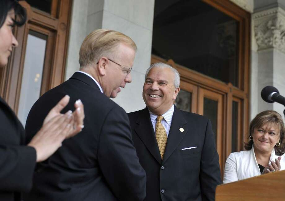Lt. Gov. Michael Fedele, a candidate for the Republican nomination for governor, second from right, calls Danbury Mayor Mark Boughton, second from left, to speak after announcing Boughton as his running mate outside the Capitol in Hartford, Conn., Monday, May 17, 2010.  At left is Boughton's wife Phyllis, and right is Fedele's wife Carol.  (AP Photo/Jessica Hill) Photo: Jessica Hill, AP / FR125654 AP