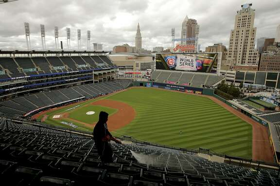 A worker prepares the stadium for baseball's upcoming World Series between the Cleveland Indians and the Chicago Cubs, Monday, Oct. 24, 2016, in Cleveland. (AP Photo/Charlie Riedel)