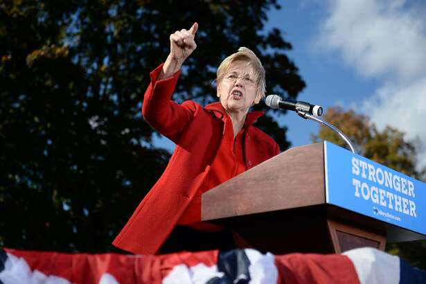 Sen. Elizabeth Warren speaks at a campaign rally for Democratic presidential nominee Hillary Clinton, October 24, 2016 at Saint Anselm College in Manchester, New Hampshire. / AFP PHOTO / Robyn BECKROBYN BECK/AFP/Getty Images