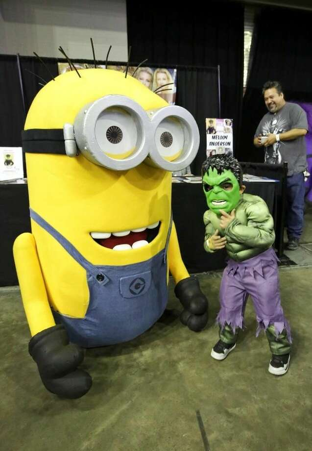 """Juanito Carillo, right, poses with Minion Phil, a character from the movie """"Despicable Me 2,"""" on Saturday afternoon during the South Texas Collectors Expo at the Laredo Energy Arena. See related photo, story in Monday's paper and e-Edition. Photo by Victor Strife"""