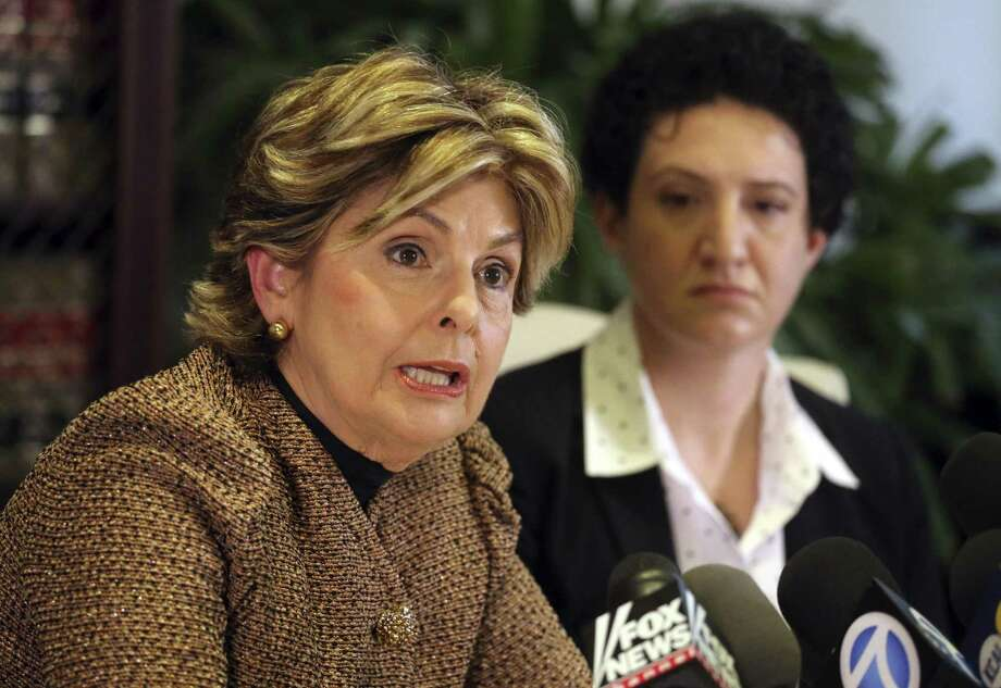 Ann Russo, right, who describes herself as a friend of Donald Trump accuser Summer Zervos, and attorney Gloria Allred discuss Russo's experience with Zervos and the claims against Trump, at a news conference in Los Angeles Sunday, Oct. 16, 2016. Russo said that Zervos told her in about 2010 that Trump had been verbally, physically and sexually aggressive with her during a job interview at that time. (AP Photo/Reed Saxon) Photo: Reed Saxon / Associated Press / Copyright 2016 The Associated Press. All rights reserved. This material may not be published, broadcast, rewritten or redistribu