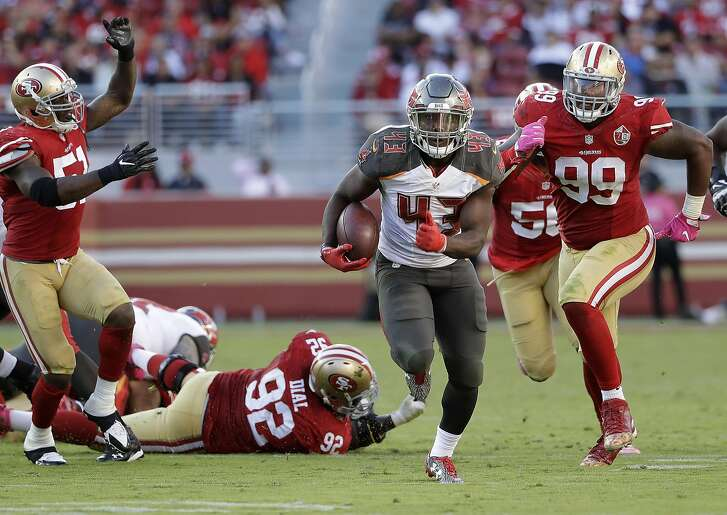 Tampa Bay Buccaneers running back Peyton Barber (43) runs for a touchdown against the San Francisco 49ers during the second half of an NFL football game in Santa Clara, Calif., Sunday, Oct. 23, 2016. (AP Photo/Marcio Jose Sanchez)
